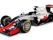 Première F1 conçue par Haas, la VF-16 arbore une livrée rouge et grise typique de la marque américaine.